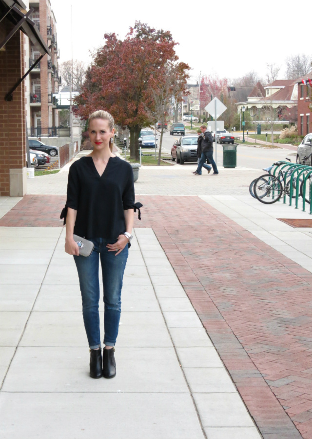 tie sleeve top, distressed jeans, black heeled ankle boots, jeweled clutch, chanel red lipstick, bloomington indiana style blog