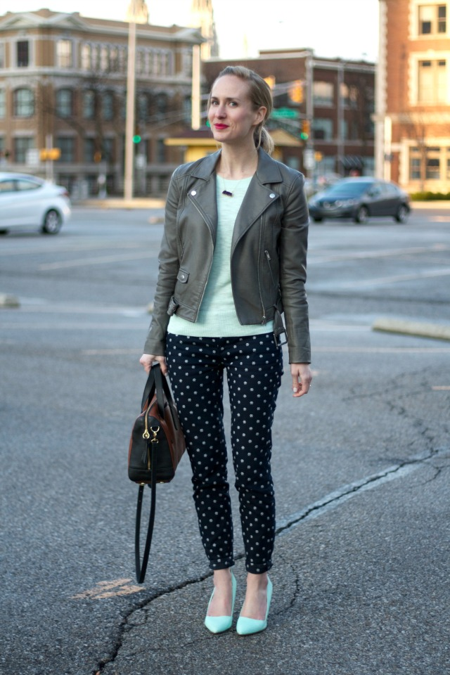 gray moto jacket, floral jeans, mint green pumps, Fossil Sydney satchel