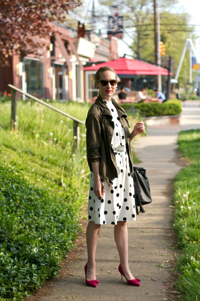 black and white polka dot dress, army jacket, pink bow pumps