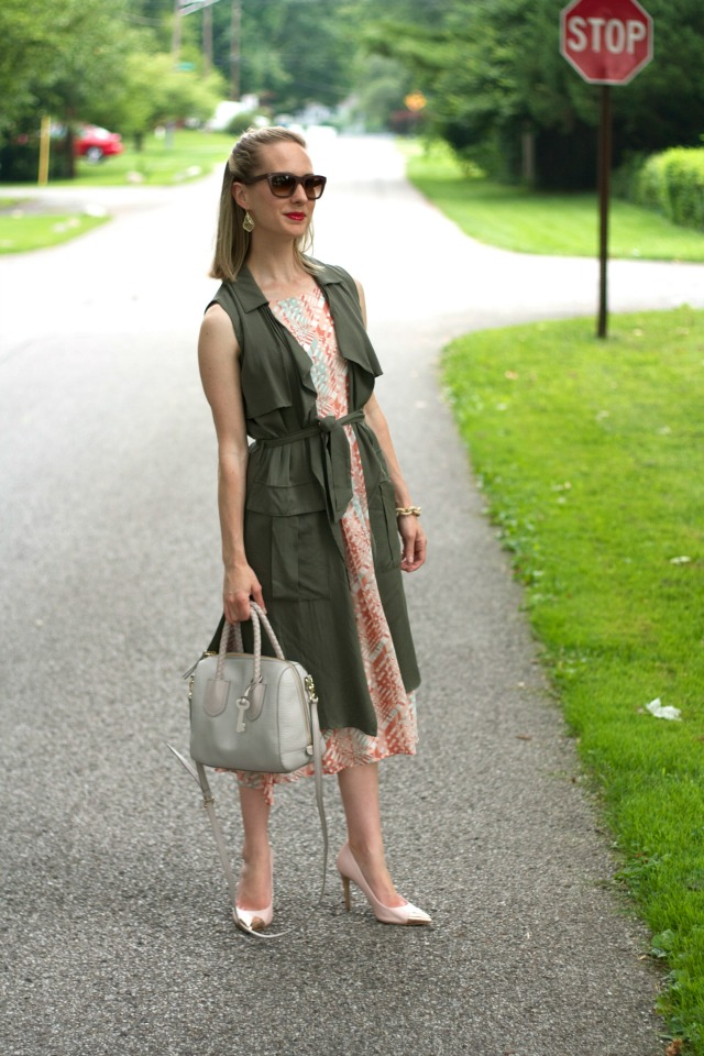 pink midi dress, long olive vest, gold Kendra Scott earrings