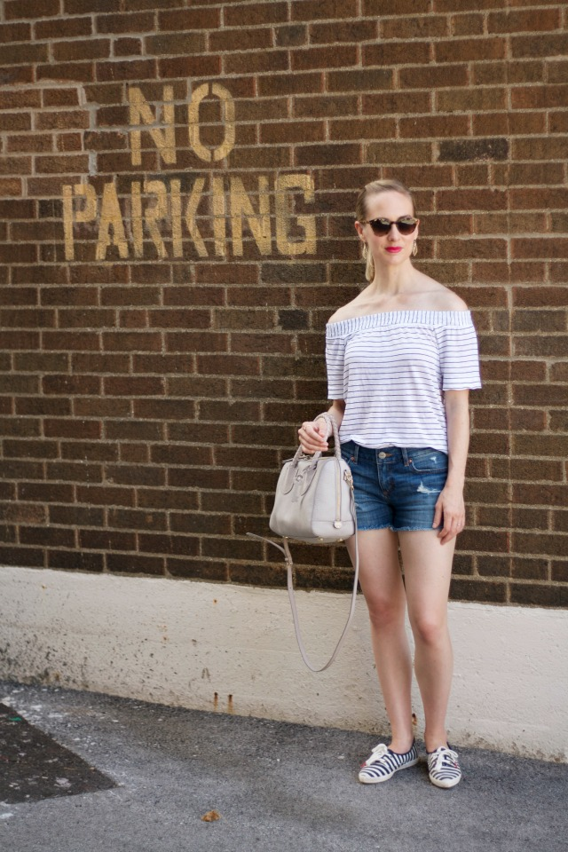 off the shoulder striped tee, distressed denim shorts, Kendra Scott gold drop earrings, gray Fossil Sydney satchel, Kate Spade Ked sneakers