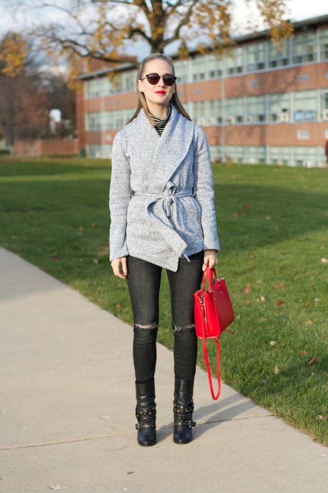 belted sweater jacket, distressed gray skinny jeans, biker boots, gemstone ring