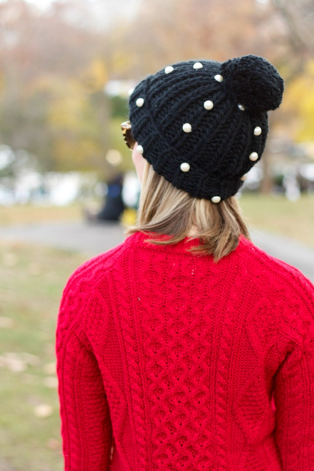 red sweater, faux leather leggings, white Chucks, J.Crew wool trench, cable knit beanie