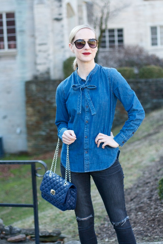 chambray bow shirt, distressed black jeans, white Converse, quilted handbag