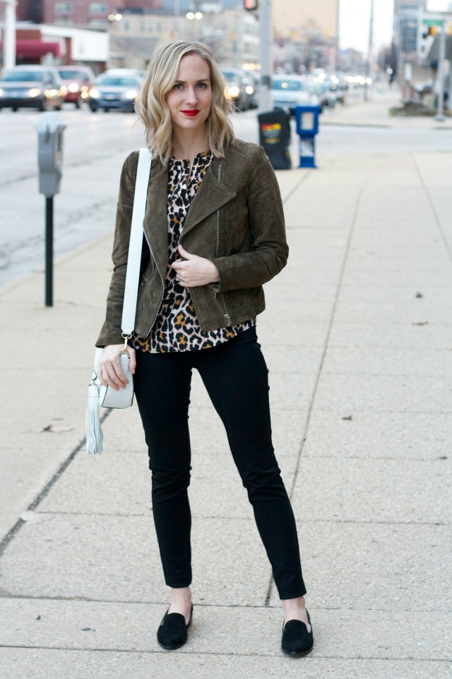 suede moto jacket, leopard blouse, skinny black pants, suede loafers, Rebecca Minkoff tassel bag