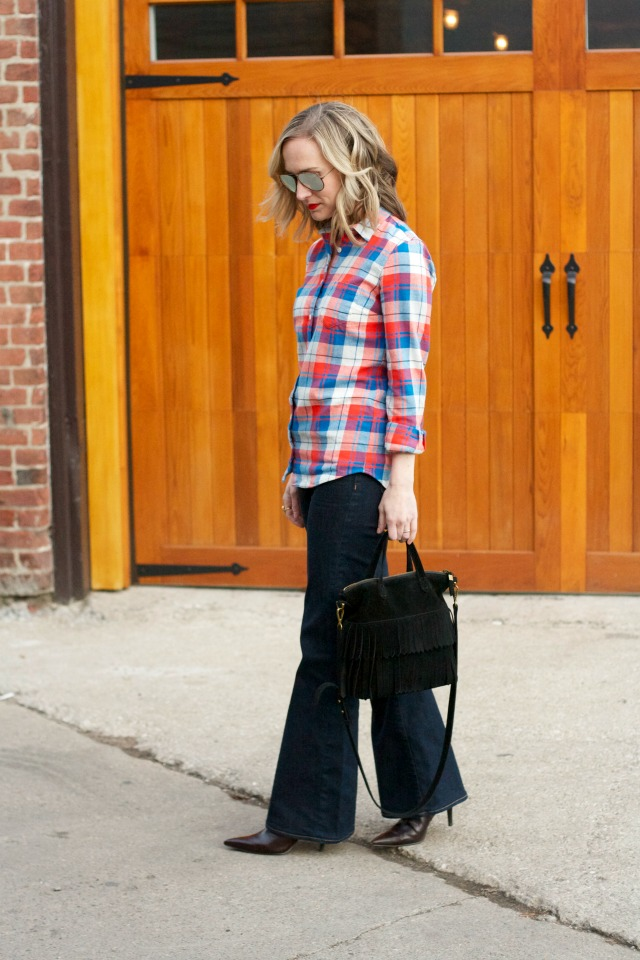 plaid flannel shirt, flare jeans, fringe transport tote, aviator sunglasses