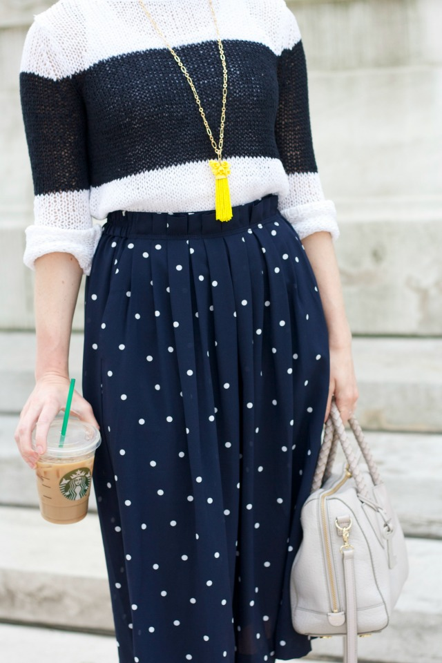 polka dot midi skirt, colorblock sweater, ankle strap pumps, tassel necklace