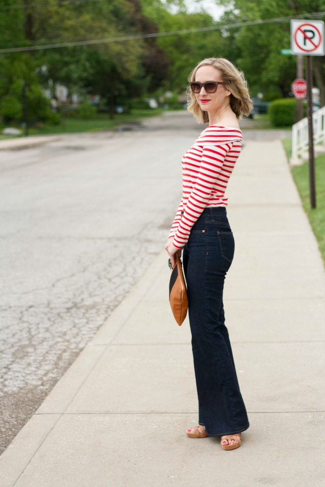 striped off-the-shoulder top, high waist flare jeans, colorblock clutch