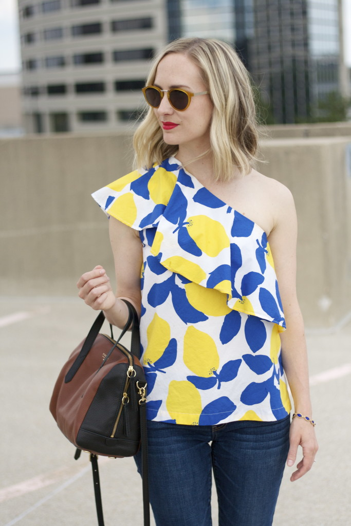 one shoulder lemon print top, skinny jeans, gold flats