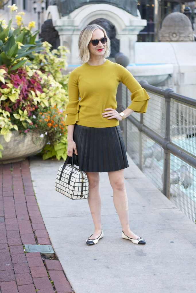 chartreuse bell sleeve sweater, leather skirt, cap toe gemma flats