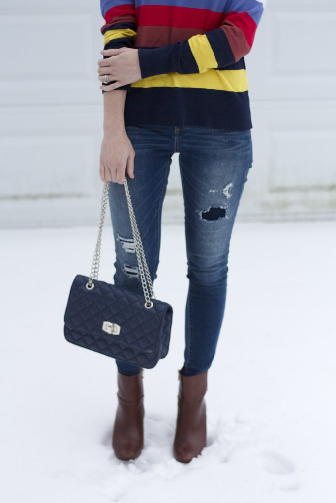 bow back sweater, jeans and ankle boots, quilted bag